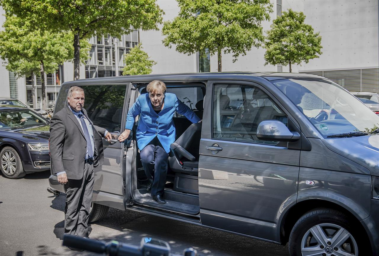 Merkel won't attend G7 summit in person if US goes ahead
