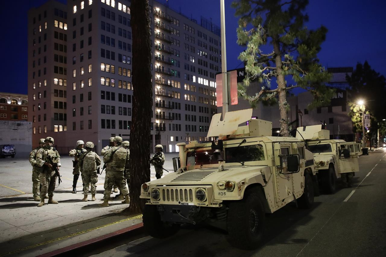 The Latest: Police say 4 officers shot in St. Louis protests