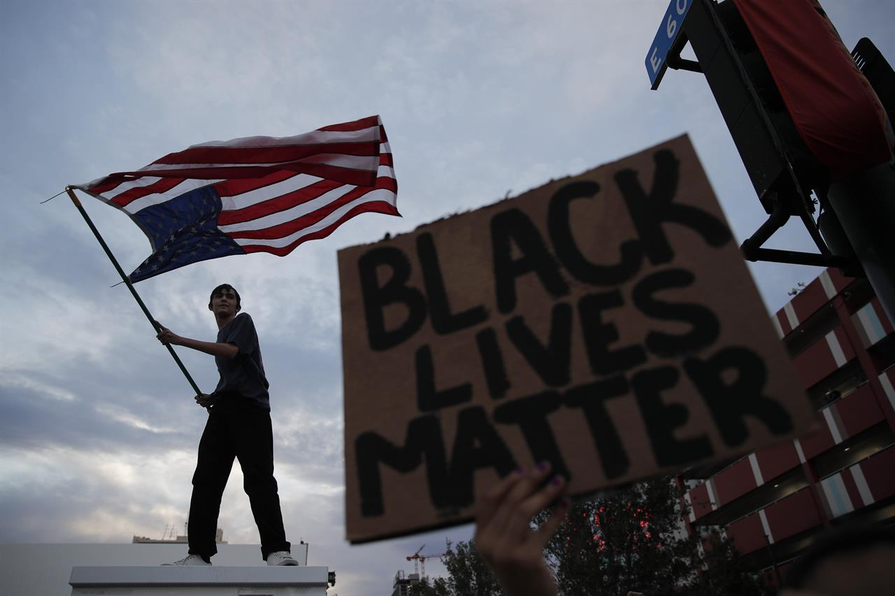 AP PHOTOS:  A weekend of protests in America