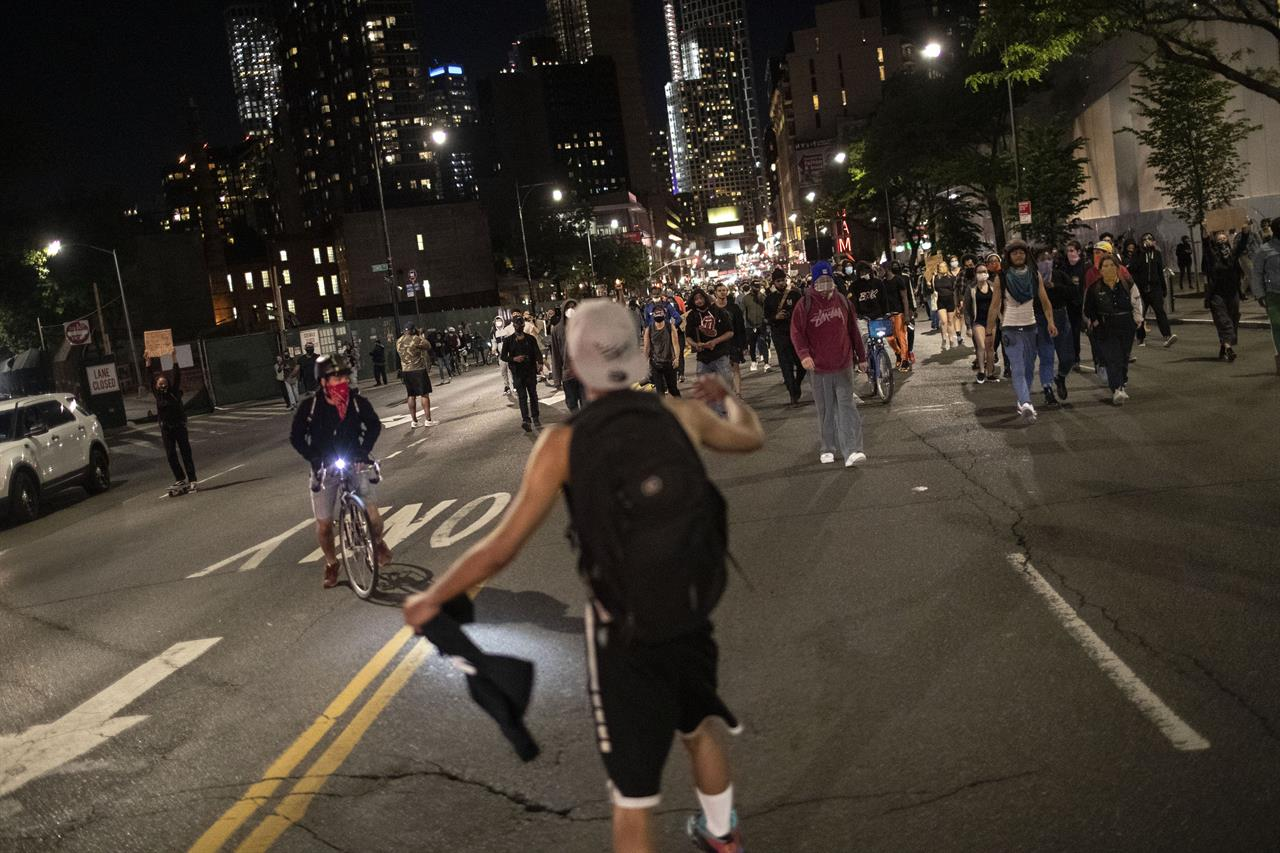 The Latest: Thousands on New York City streets after curfew