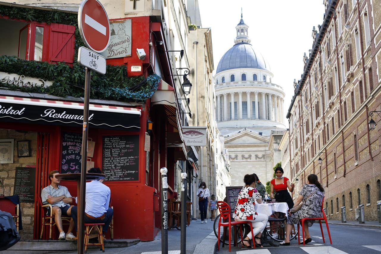 AP PHOTOS: Croissants and hand gel as Paris cafes reawaken