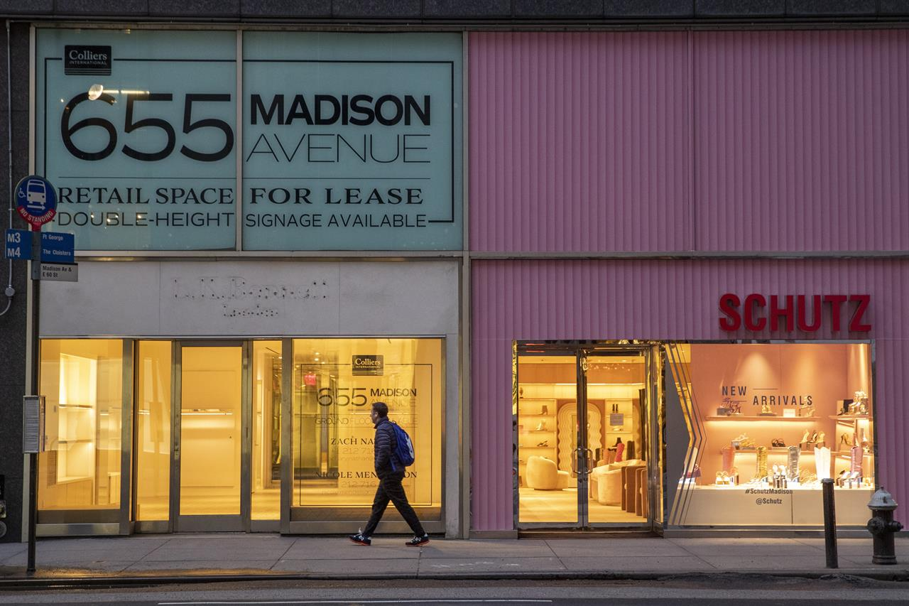 FILE- In this Thursday, March 19, 2020, file photo, a pedestrian walks past a storefront for rent on Madison Avenue, in New York. The coronavirus has had an impact on the commercial real estate markets. AP Photo/Mary Altaffer, File)