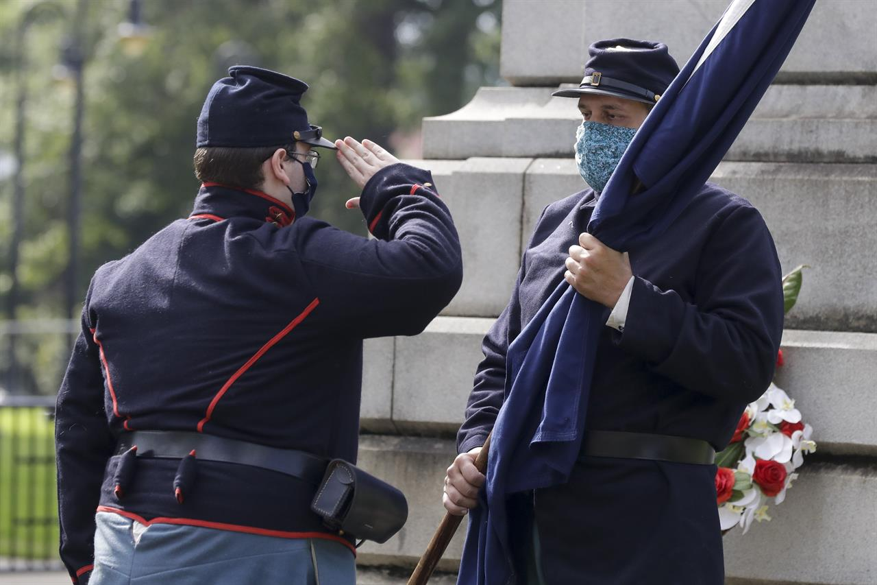 Protester: Man pulls gun on anniversary of flag's removal