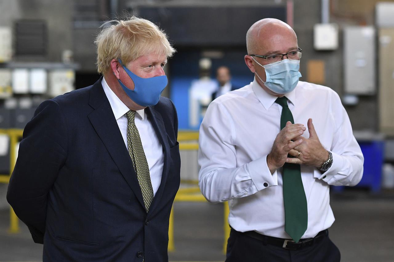 In reversal, UK says it will make masks mandatory in shops