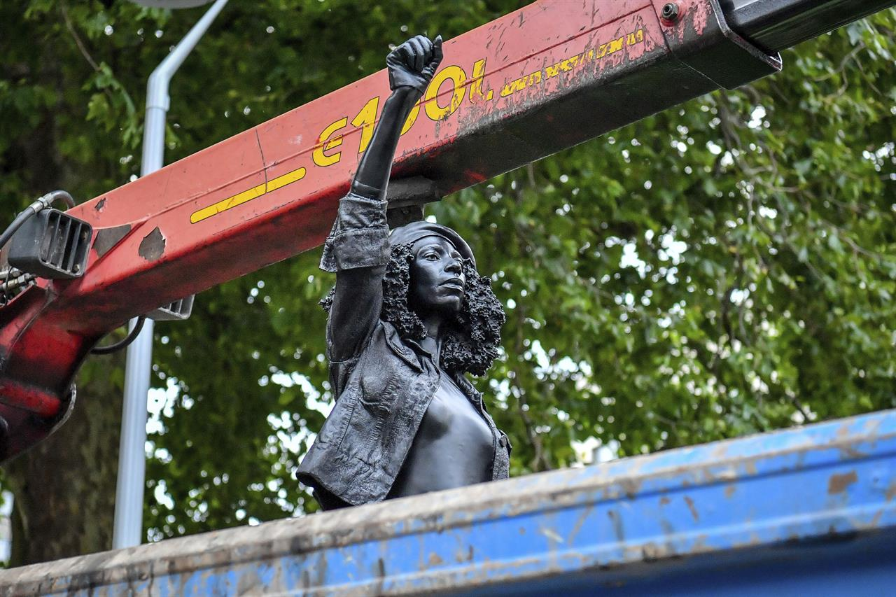 Black UK protester statue removed from pedestal in Bristol