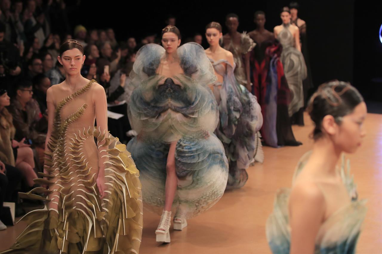 Paris couture climbs Mount Olympus, plumbs marine depths
