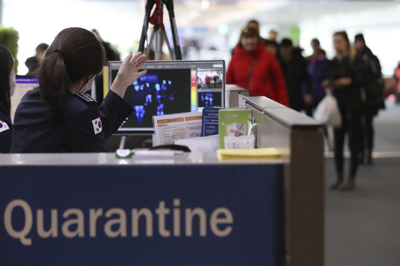 Virus prompts temperature checks, extra cleaning at airports