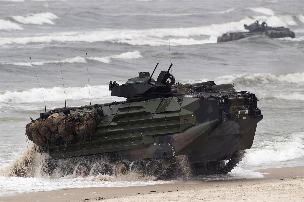 FILE - A U.S. Marine Amphibious Assault Vehicle (AAV) takes part in a landing operation during a military Exercise Baltops 2018, at the Baltic Sea near Vilnius, Lithuania, Monday, June 4, 2018. A training accident off the coast of Southern California in an AAV similar to this one has taken the life of one Marine, injured two others and left eight missing Thursday, July 30, 2020. In a Friday morning tweet, the Marines say the accident happened Thursday and search and rescue efforts are underway with support from the Navy and Coast Guard. (AP Photo/Mindaugas Kulbis, File)