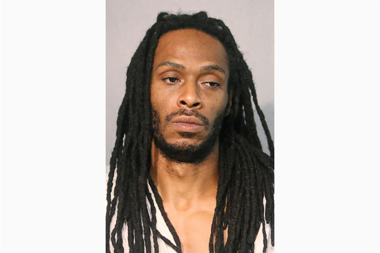 This undated photo provided by the Chicago Police Department shows Darrell Johnson. Authorities announced Tuesday, Aug. 4, 2020, that they have charged Johnson with first-degree murder in the death of 9-year-old Janari Ricks, who was fatally shot while playing in front of his Chicago home Friday, July 31. (Chicago Police Department via AP)