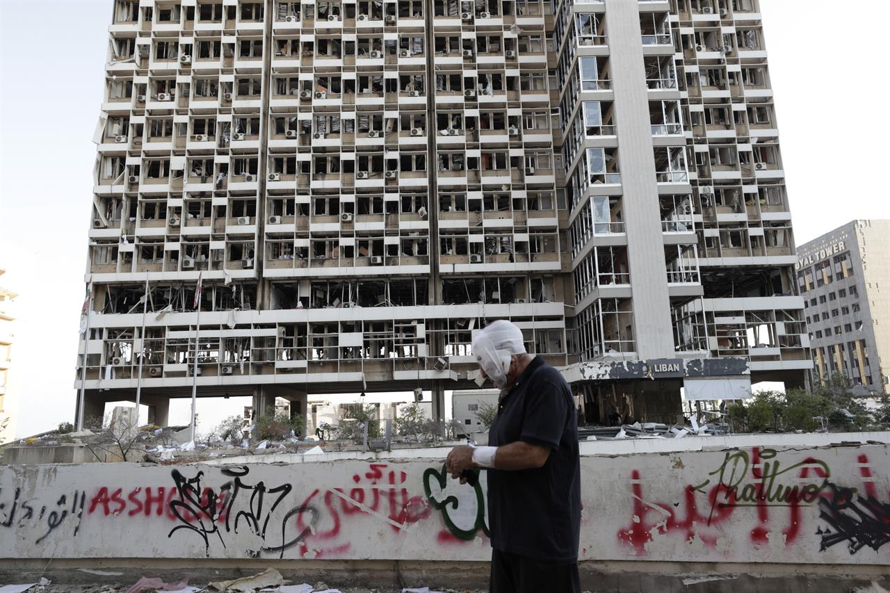 AP PHOTOS:  Beirut images show shattered, dust-covered city