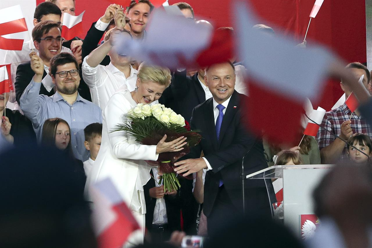 Poland's leader sworn in for 2nd term as critics stay away
