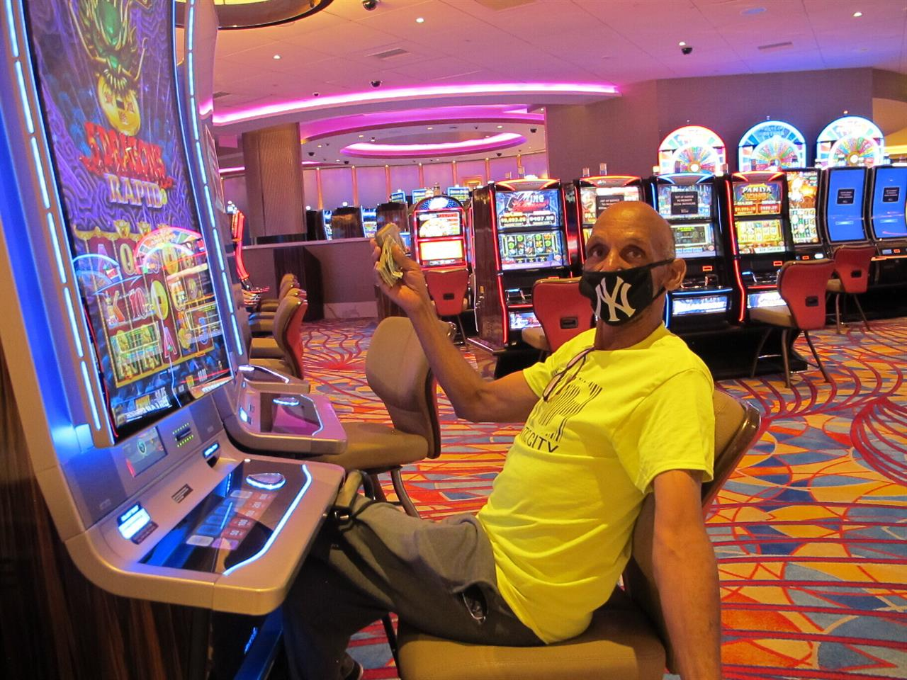 NJ casinos, tracks win $264M in July after virus reopening