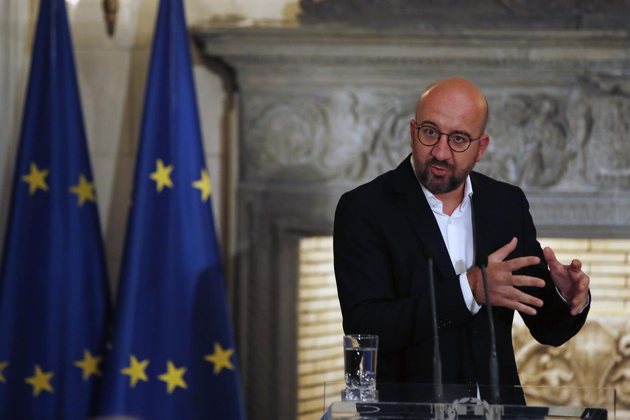 European Council President Charles Michel makes statements after his meeting with Greece's Prime Minister Kyriakos Mitsotakis at Maximos Mansion in Athens, Tuesday, Sept. 15, 2020. Michel will visit Lesbos later today as Greece's migration minister says the government will use force if necessary to move homeless migrants to a new facility on the island after thousands of people were left without shelter by fires last week at an overcrowded refugee camp. (AP Photo/Thanassis Stavrakis)