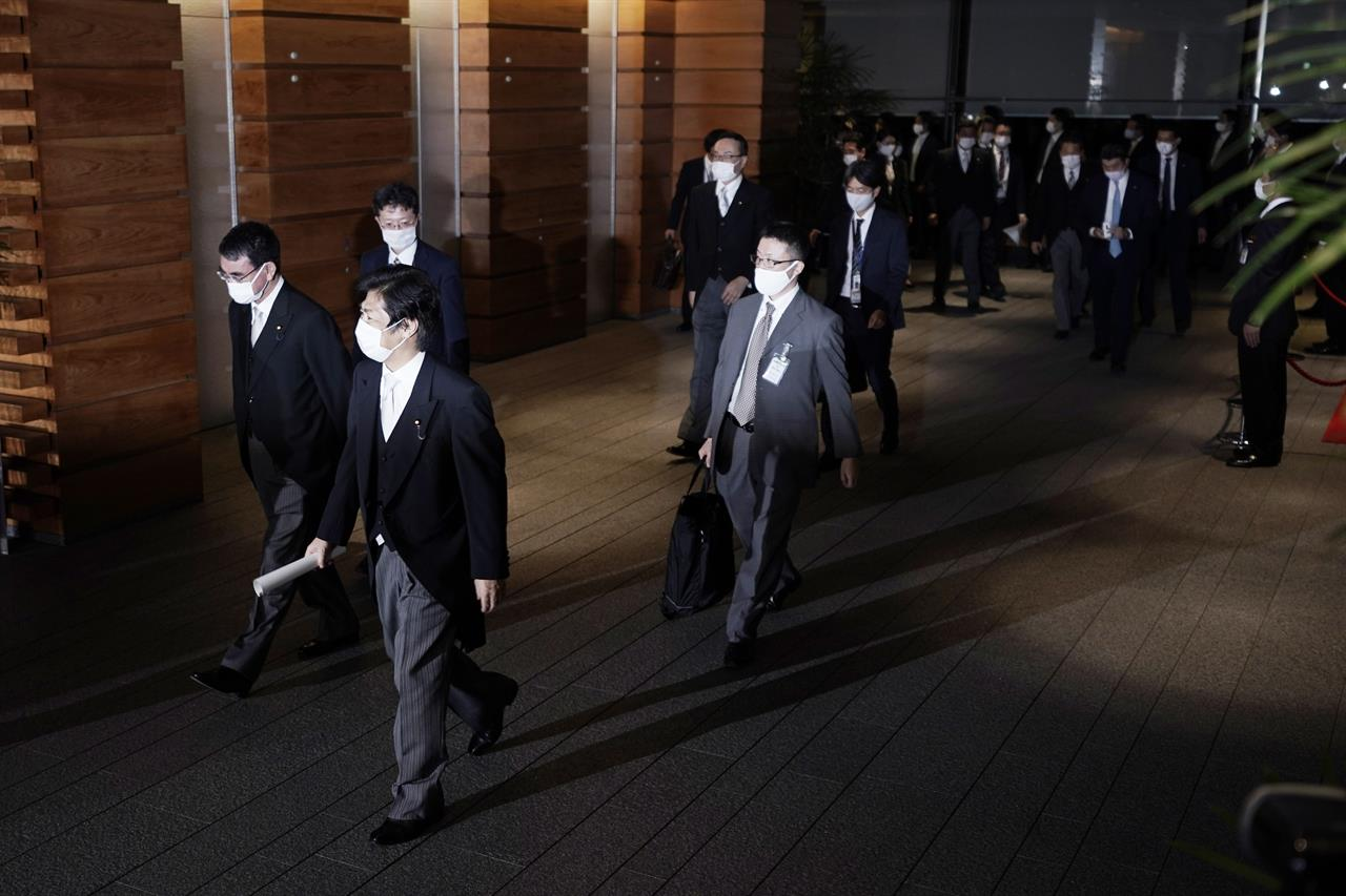 New Japanese Cabinet retains most key ministers