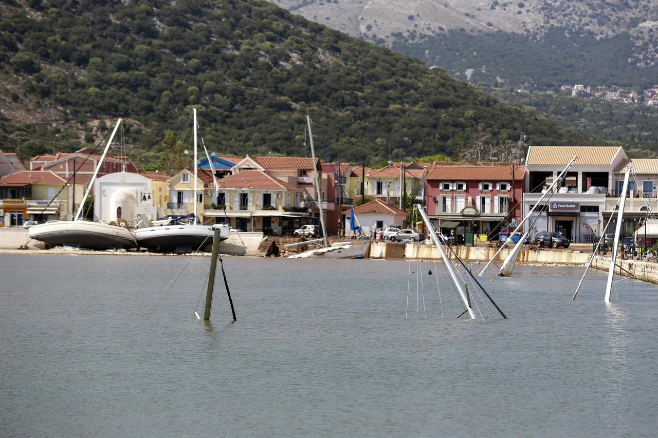 Yachts are sunk following a storm at the village of Agia Efimia, on the Ionian island of Kefalonia, western Greece, Sunday, Sept. 20, 2020. A powerful tropical-like storm named Ianos, battered parts of central Greece and some of the western Ionian islands, as emergency workers rescued more than 600 people. (AP Photo/Nikiforos Stamenis)