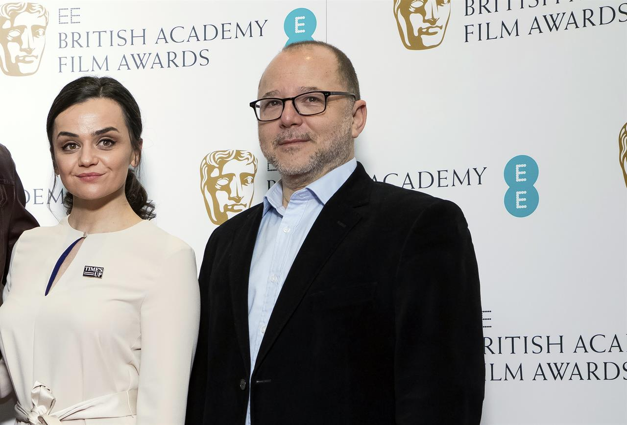 """FILE - In this Wednesday, Jan. 9, 2019 file photo, BAFTA Chair of the Film Committee Marc Samuelson poses for photographers next to actor Hayley Squires in London. The British Academy of Film and Television Arts promised to change after nominations for the 2020 awards were announced last January. No women were nominated as best director for the seventh year running, and all 20 nominees in the lead and supporting performer categories were white. """"We said on the day, 'We're going to review everything,'"""" BAFTA film committee chairman Marc Samuelson said Thursday, Sept. 24. 2020 as the academy announced a slate of changes.  (Photo by Vianney Le Caer/Invision/AP, file)"""