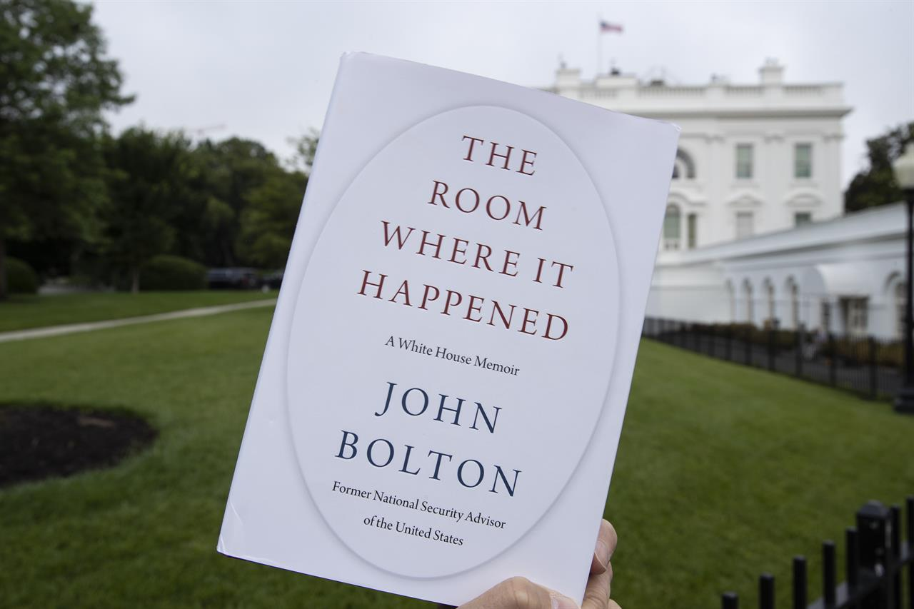 """FILE - In this June 18, 2020, file photo a copy of """"The Room Where It Happened,"""" by former national security adviser John Bolton, is photographed at the White House in Washington. Trump administration officials repeatedly exerted political pressure in an unsuccessful effort to block the release of former national security adviser John Bolton's tell-all book, a career government records professional said in a court filing Wednesday, Sept. 23. (AP Photo/Alex Brandon, File)"""