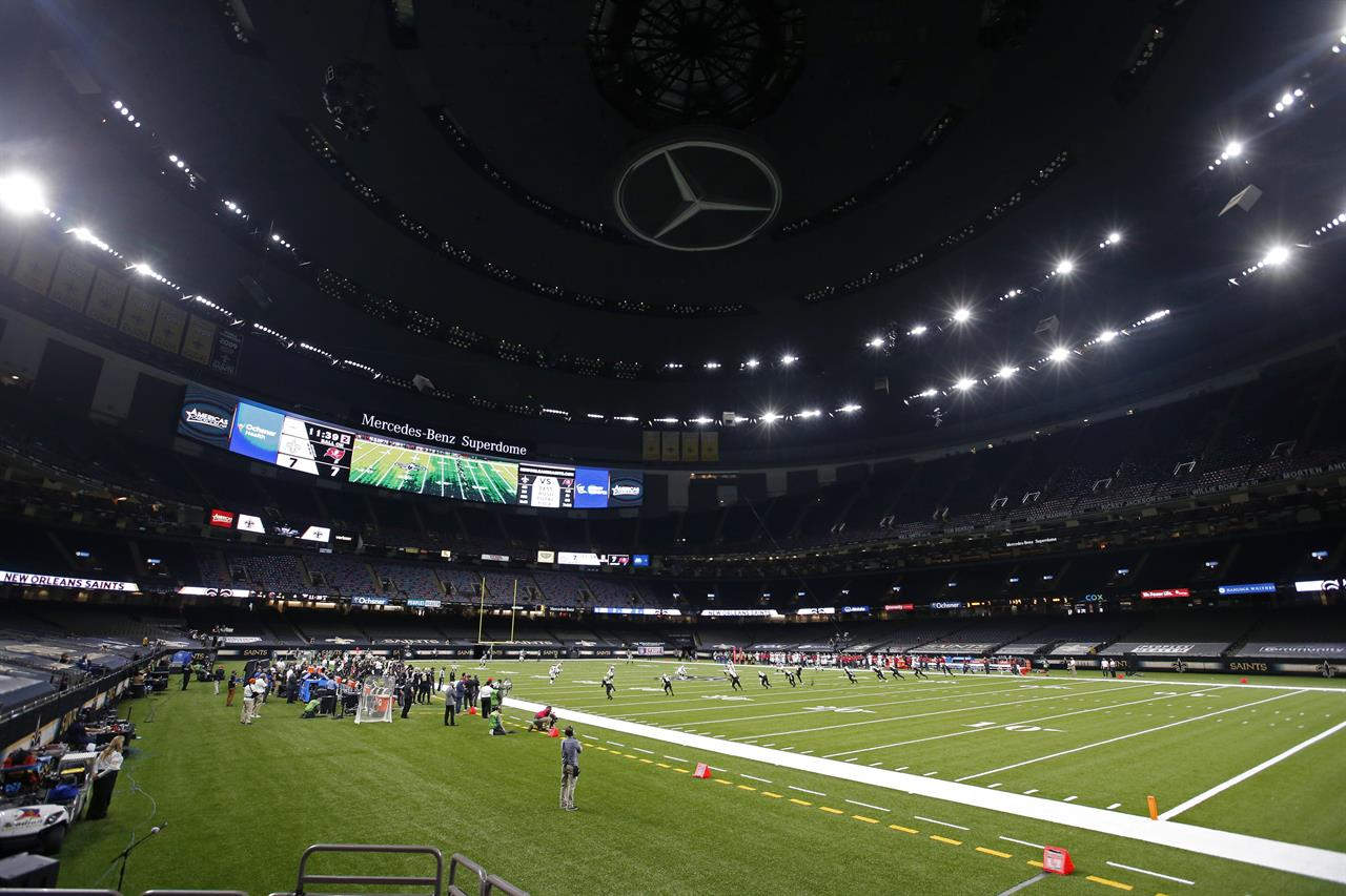 The Latest: Saints to allow family members for Packers game