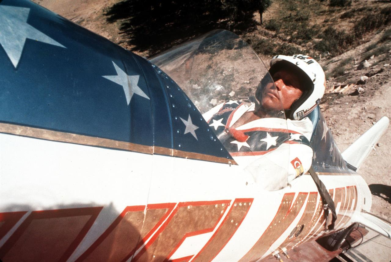 """FILE - In this Sept. 8, 1974, file photo, Evel Knievel sits in the steam-powered rocket motorcycle that will hopefully take him across Snake River Canyon in Twin Falls, Idaho. Evel Knievel's son is on a collision course with the Walt Disney Co. and Pixar over a movie daredevil character named Duke Caboom. A federal trademark infringement lawsuit filed Tuesday, Sept. 22, 2020, in Las Vegas accuses the moviemaker of improperly basing the """"Toy Story 4"""" character on Knievel. (AP Photo, File)"""