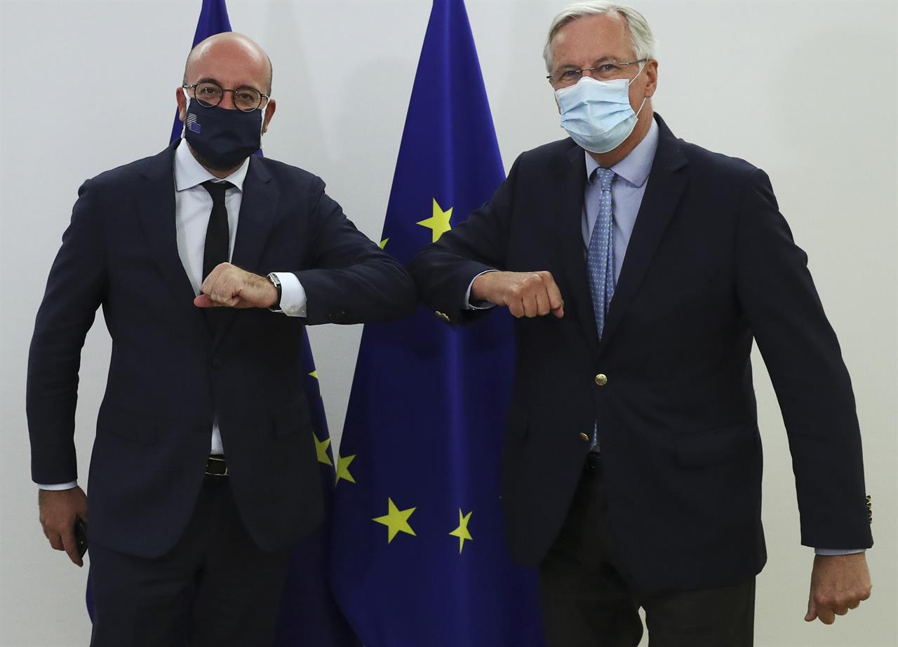 European Commission's Head of Task Force for Relations with the United Kingdom Michel Barnier, right, meets with European Council President Charles Michel at the EU Council building in Brussels, Friday, Sept. 18, 2020. (Yves Herman, Pool via AP)
