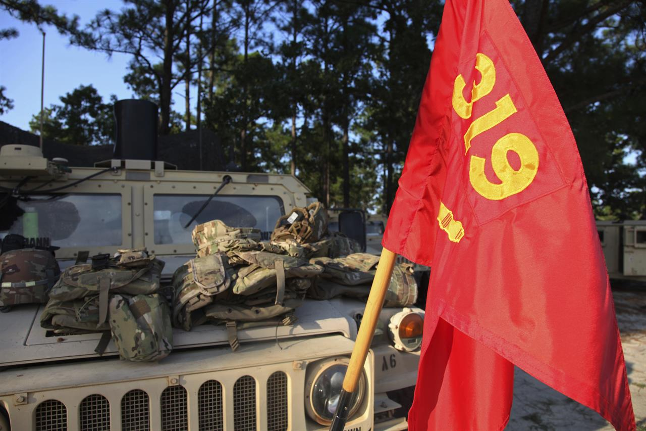 A flag representing the 82nd Airborne Division's 1-319th Field Artillery Regiment hangs from a Humvee in a remote location on Fort Bragg, N.C. on Wednesday, August 26, 2020. Days after learning of Staff Sergeant Jason Lowe's suicide, his unit started three weeks of field training. Chaplains visited soldiers to offer counseling and support. (AP Photo/Sarah Blake Morgan)
