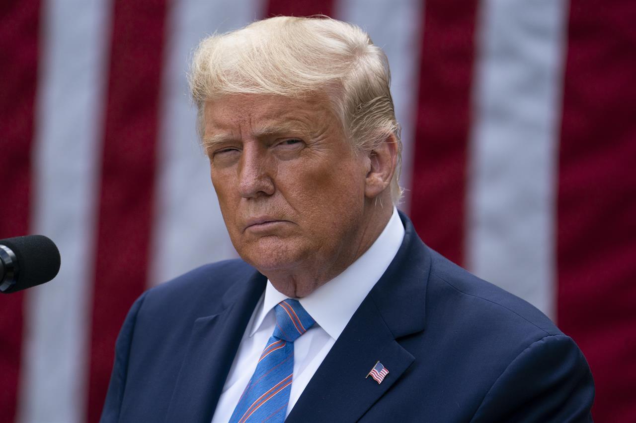 The Latest: Trump casts election doubts, Biden urges voting