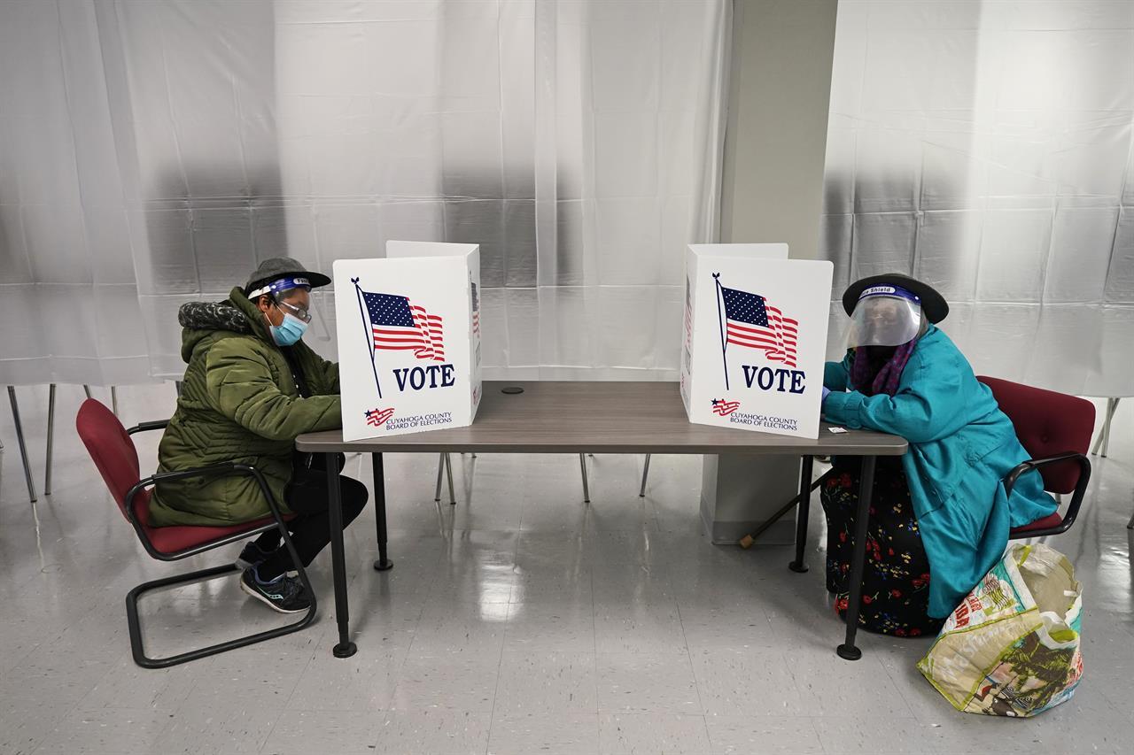 Virus surges in key battleground states as election nears