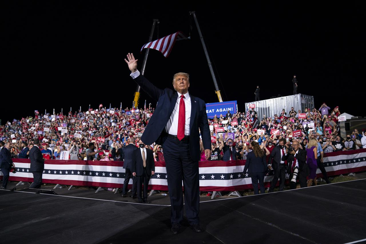 President Donald Trump waves to the crowd as he walks off stage after speaking at a campaign rally at Gastonia Municipal Airport, Wednesday, Oct. 21, 2020, in Gastonia, N.C. (AP Photo/Evan Vucci)