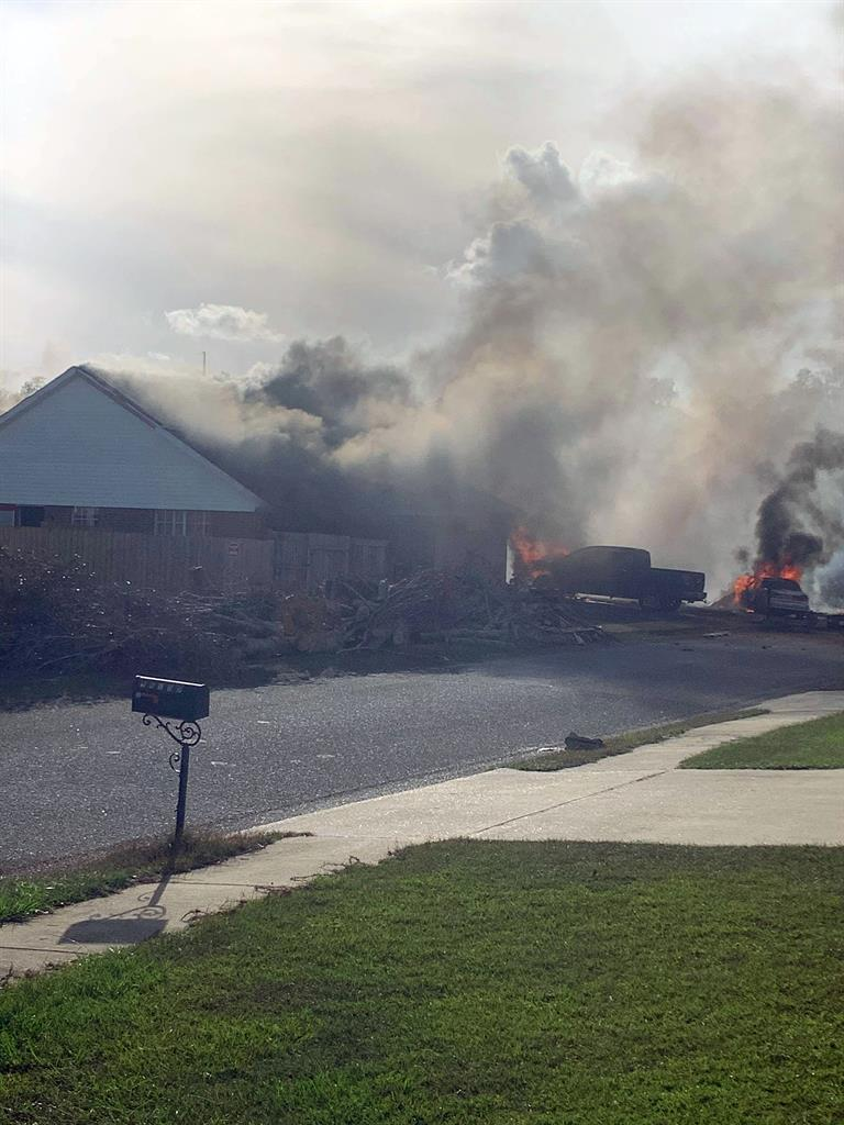 This photo provided by Greg Crippen shows the scene where a U.S. Navy training plane crashed in an Alabama residential neighborhood near the Gulf Coast, Friday, Oct. 23, 2020 near Foley, Ala. (Greg Crippen via AP)