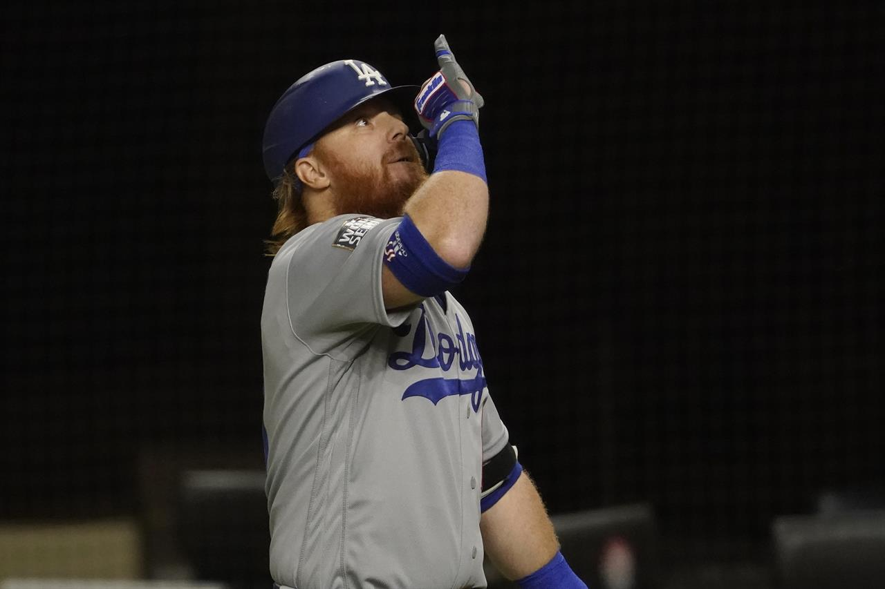 Los Angeles Dodgers' Justin Turner celebrates his home run against the Tampa Bay Rays during the first inning in Game 3 of the baseball World Series Friday, Oct. 23, 2020, in Arlington, Texas. (AP Photo/Tony Gutierrez)