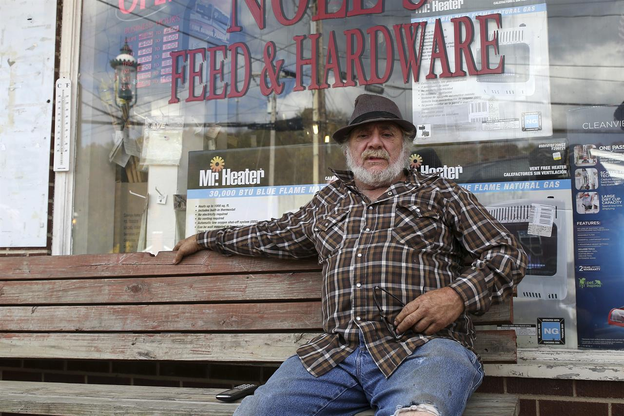 Howard Eakle, 64, discusses the increase in cases of the coronavirus in West Union, W.Va., Wednesday Oct. 21, 2020. (AP Photo/Kathleen Batten)