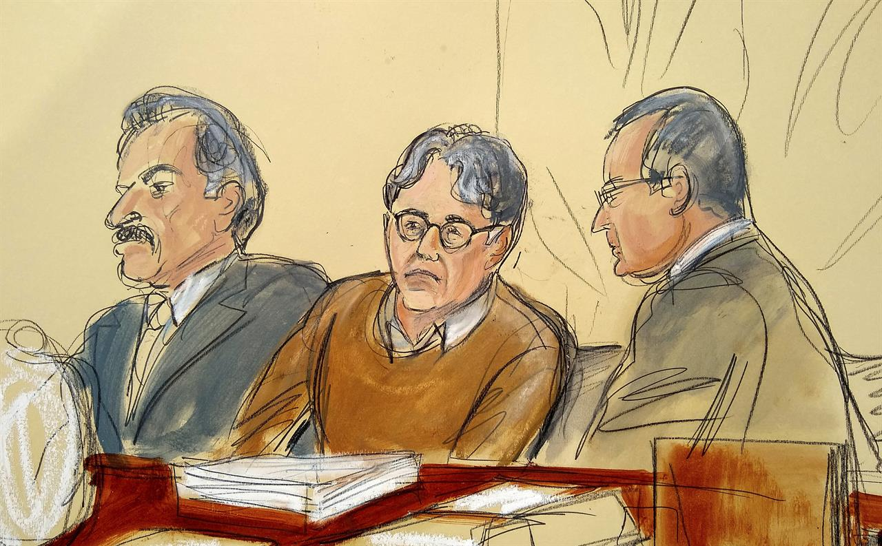 FILE - In this Tuesday, May 7, 2019, file courtroom drawing, defendant Keith Raniere, center, leader of the secretive group NXIVM, is seated between his attorneys Paul DerOhannesian, left, and Marc Agnifilo during the first day of his sex trafficking trial. Raniere, a self-improvement guru whose organization NXIVM attracted millionaires and actresses among its adherents, faces sentencing Tuesday, Oct. 27, 2020, on convictions that he turned some female followers into sex slaves branded with his initials. (Elizabeth Williams via AP, File)