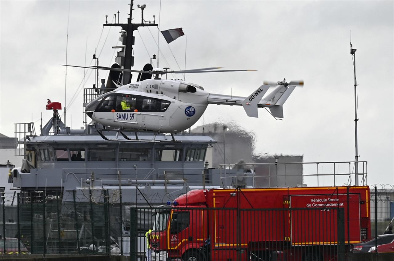 A French rescue helicopter lands close to a rescue vessel in Dunkirk, northern France, Tuesday, Oct. 27, 2020 during asearch operation after four migrants, including a 5-year-old and 8-year-old child died Tuesday when their boat capsized while they and other migrants tried to cross the English Channel to Britain, French authorities said. Fifteen migrants have been saved so far and rescue and search operations are still under way, according to the regional administration for the Nord region. (AP Photo)