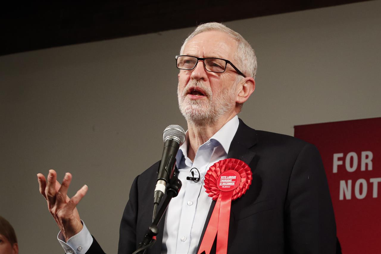 """FILE - In this Wednesday, Dec. 11, 2019 file photo, Labour Leader Jeremy Corbyn addresses an eve of poll rally in London. Britain's equalities watchdog said Thursday, Oct. 29, 2020 that officials in the country's main opposition Labour Party failed to stamp out anti-Semitism and committed """"unlawful acts of harassment and discrimination"""" against the Jewish community. Labour has faced allegations that anti-Semitism was allowed to fester under the 2015-2019 leadership of Jeremy Corbyn, a long-time supporter of Palestinians and a critic of Israel. (AP Photo/Thanassis Stavrakis, file)"""