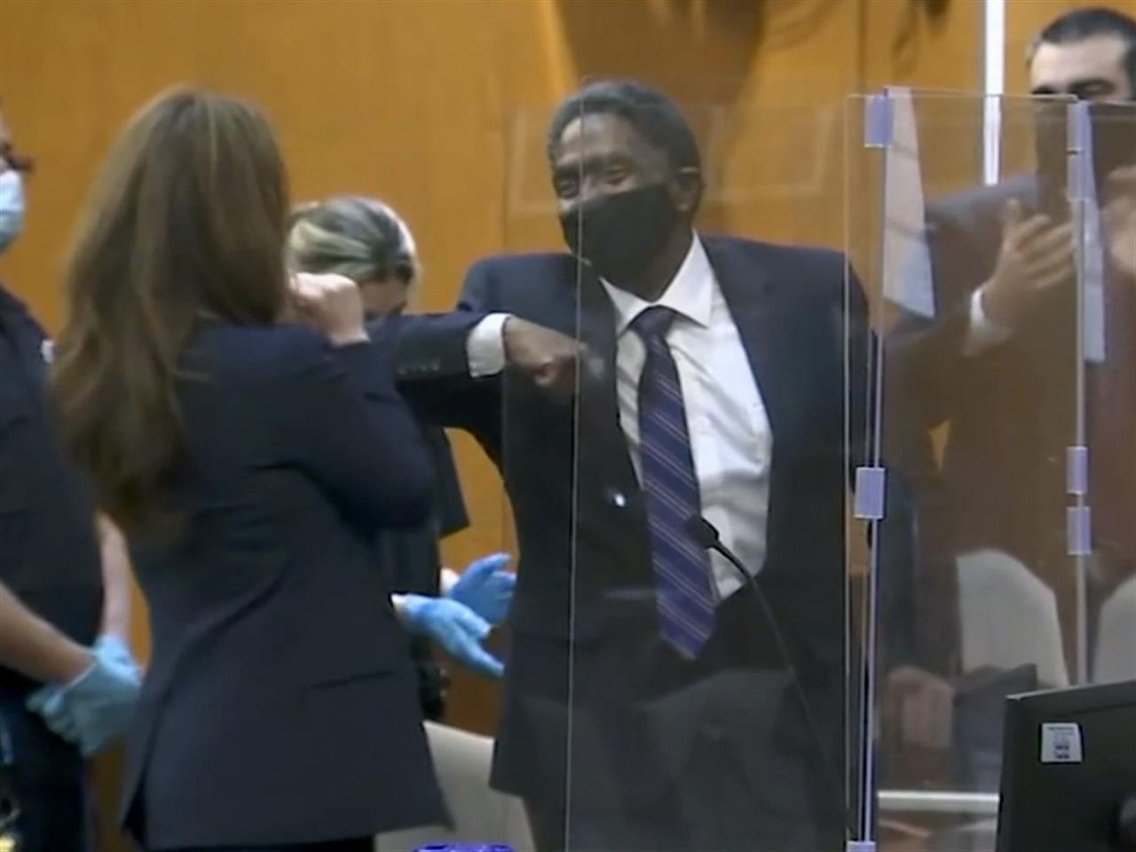 In this image made from video provided by WABC TV, Jaythan Kendrick, center, celebrates in a New York City courtroom, Thursday, Nov. 19, 2020, after being cleared of the November 1994 killing of Josephine Sanchez. After more than a quarter-century behind bars for the deadly purse-snatching, the New York man has been cleared as prosecutors acknowledged that witnesses against him, including a 10-year-old boy, weren't reliable. (WABC TV via AP)