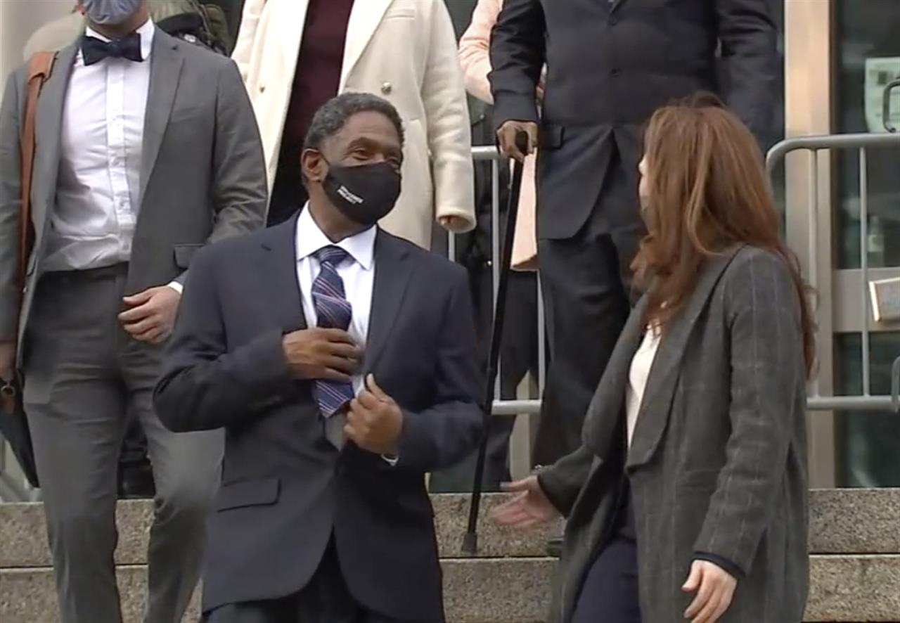 In this image made from video provided by WABC TV, Jaythan Kendrick, center, leaves the courthouse Thursday, Nov. 19, 2020, in New York, after being cleared of the November 1994 killing of Josephine Sanchez. After more than a quarter-century behind bars for the deadly purse-snatching, the New York man has been cleared as prosecutors acknowledged that witnesses against him, including a 10-year-old boy, weren't reliable. (WABC TV via AP)