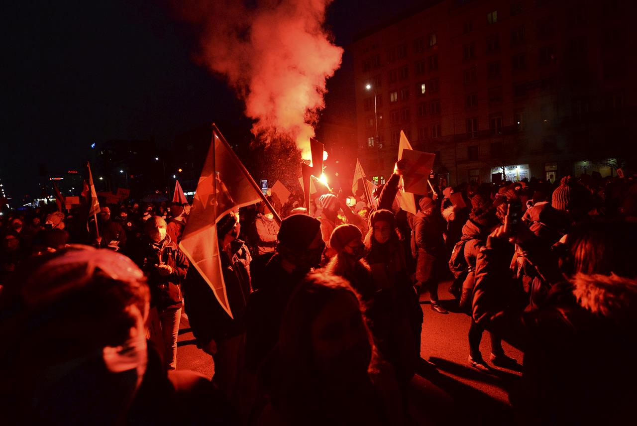 People demonstrate against police violence and an attempted restriction on abortion rights in Warsaw Poland, Saturday, Nov. 28, 2020. Nationwide protests Saturday were scheduled to coincide with Polish women gaining the right to vote 102 years ago. Weeks of protests against a high court's ruling to further restrict Abortion rights have evolved into the largest protest movement since communism fell 30 years ago.(AP Photo/Czarek Sokolowski)