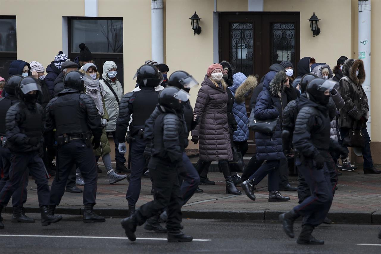 Riot police block Belarusian pensioners wearing face masks to protect against coronavirus during an opposition rally to protest the official presidential election results in Minsk, Belarus, Monday, Nov. 30, 2020. Hundreds of retirees rallied in the Belarusian capital on Monday against the country's authoritarian leader, as security forces moved to break up the traditional weekly march. The crowd of pensioners in Minsk that demanded President Alexander Lukashenko to resign ran into police cordons along the route of the march and divided into smaller groups that went into different directions. (AP Photo)