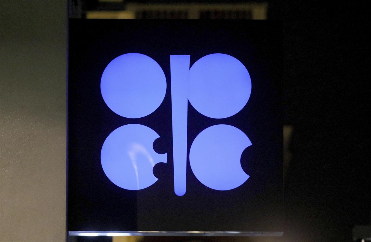 FILE - In this Dec. 19, 2019 file photo, the advertising label of the Organization of the Petroleum Exporting Countries, OPEC, shines at their headquarters in Vienna, Austria.  Leaders of the OPEC cartel are meeting virtually to decide how much oil their countries should produce as the coronavirus stifles demand for fuel. They're expected to extend production cuts into the new year in an effort to boost prices. (AP Photo/Ronald Zak, File)