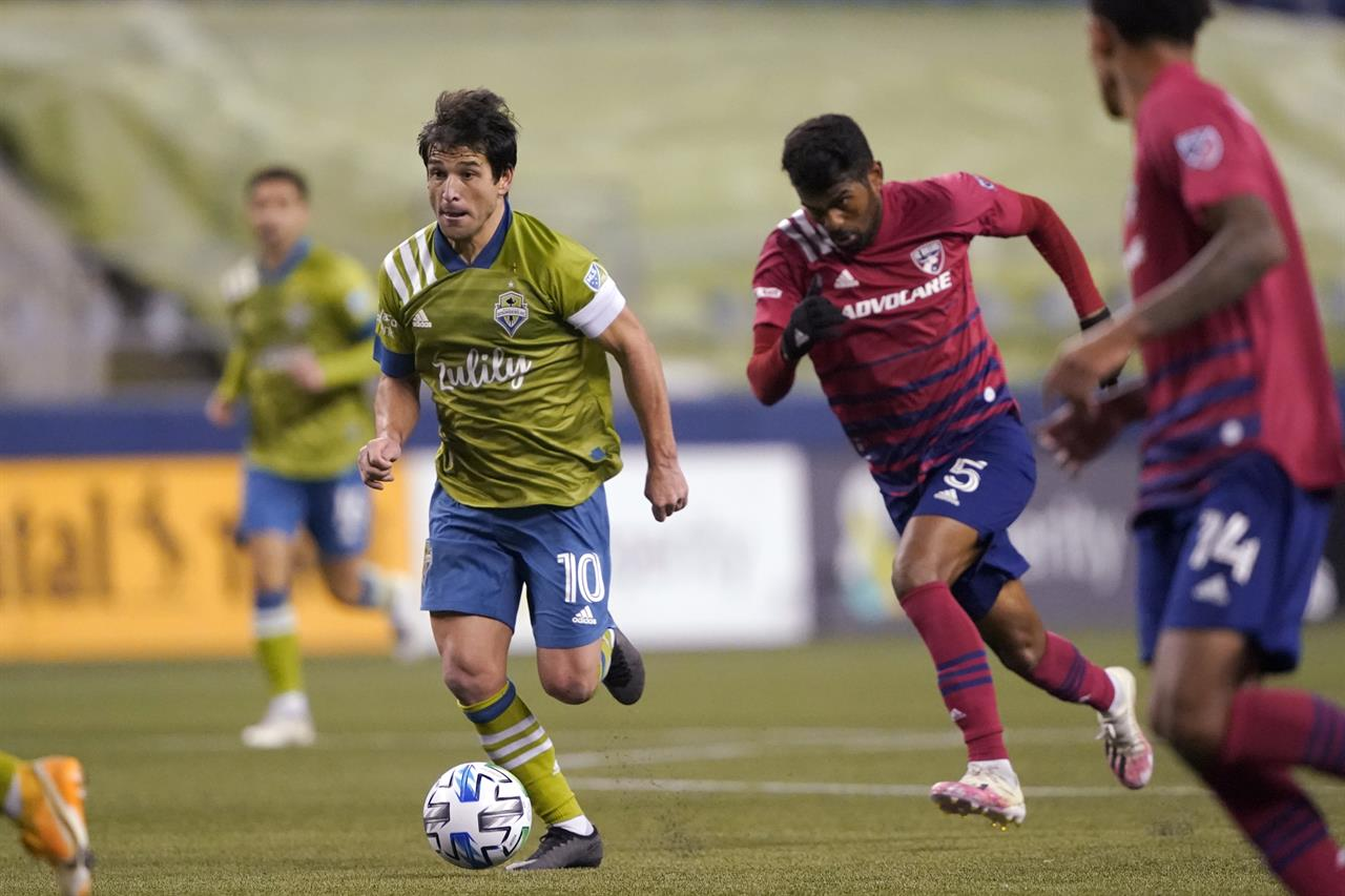 Seattle Sounders midfielder Nicolas Lodeiro (10) moves with the ball during the second half of the team's MLS playoff soccer match against FC Dallas, Tuesday, Dec. 1, 2020, in Seattle. (AP Photo/Ted S. Warren)