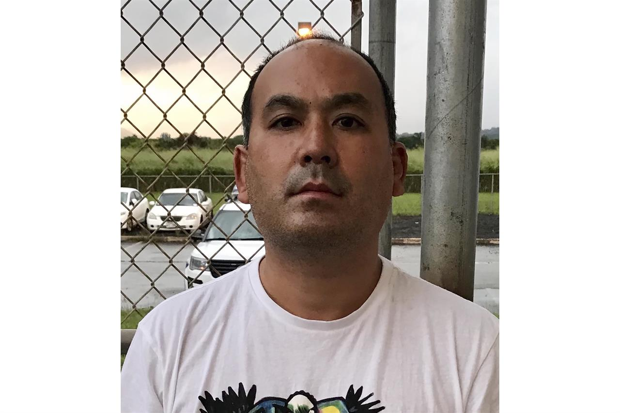 This photo provided by the Kauai Police Department shows Wesley Moribe in Lihue, Hawaii, on Nov. 29, 2020. Authorities say a couple was arrested at a Hawaii airport after traveling on a flight from the U.S. mainland despite knowing they were infected with COVID-19. The Kauai Police Department says Wesley Moribe and Courtney Peterson were arrested on suspicion of second-degree reckless endangering. (Kauai Police Department via AP)