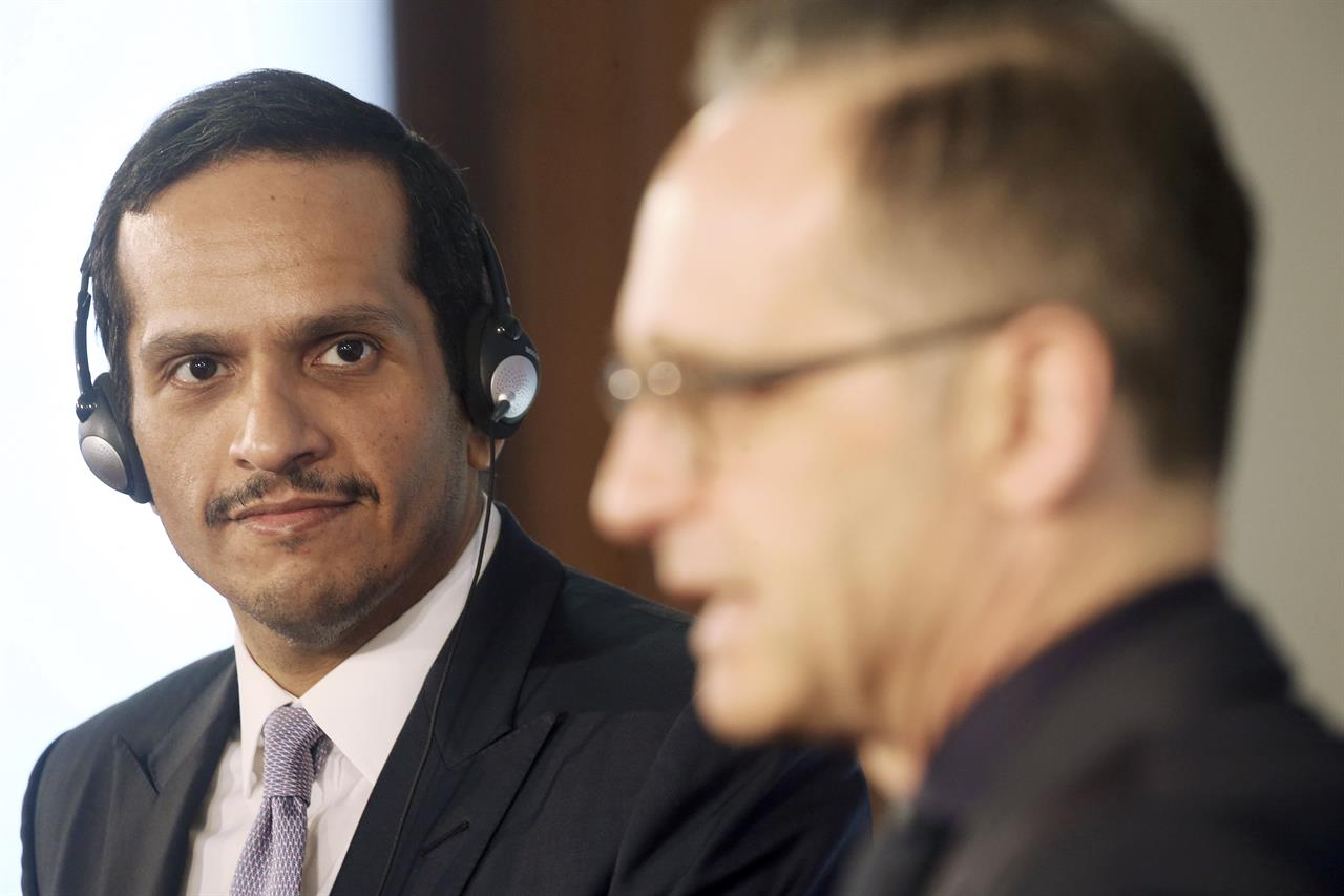 Qatar's Foreign Minister Sheikh Mohammed bin Abdulrahman Al Thani, left, and German Foreign Minister Heiko Maas, right, address the media after a meeting at the foreign office in Berlin, Germany, Wednesday, March 4, 2020.  (Wolfgang Kumm/dpa via AP)
