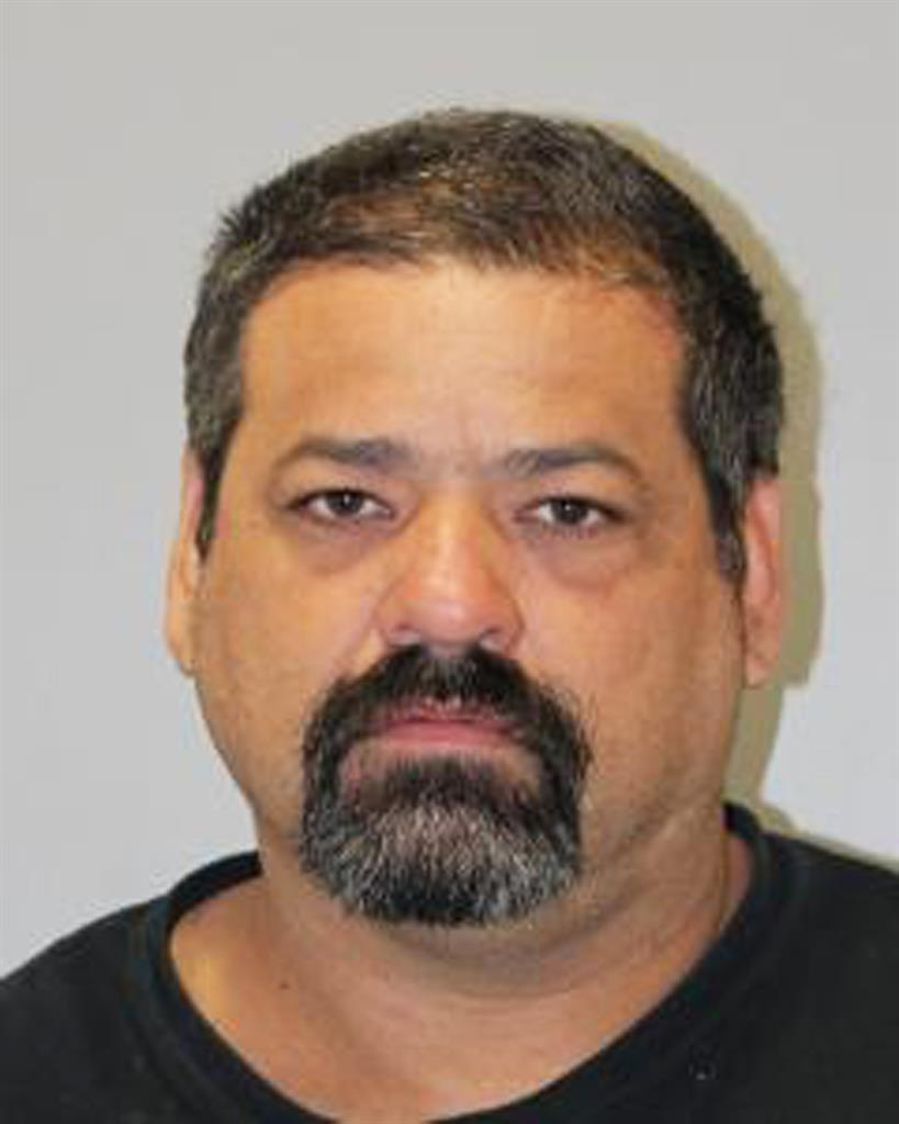 This October 2019 booking photo provided by the Kauai Police Department shows Kauai County Councilman Arthur Brun, who was arrested Thursday, Feb. 27, 2020 on drug and other charges. In October 2019, Kauai police pulled Brun over in a traffic stop after he was seen receiving meth from a gang leader, prosecutors said. U.S. prosecutors say Brun ran a meth ring while serving as an elected Kauai councilman and should be held without bail. (Kauai Police Department via AP)