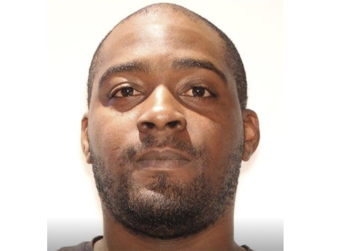 Triple-slaying suspect surrenders after standoff; child safe
