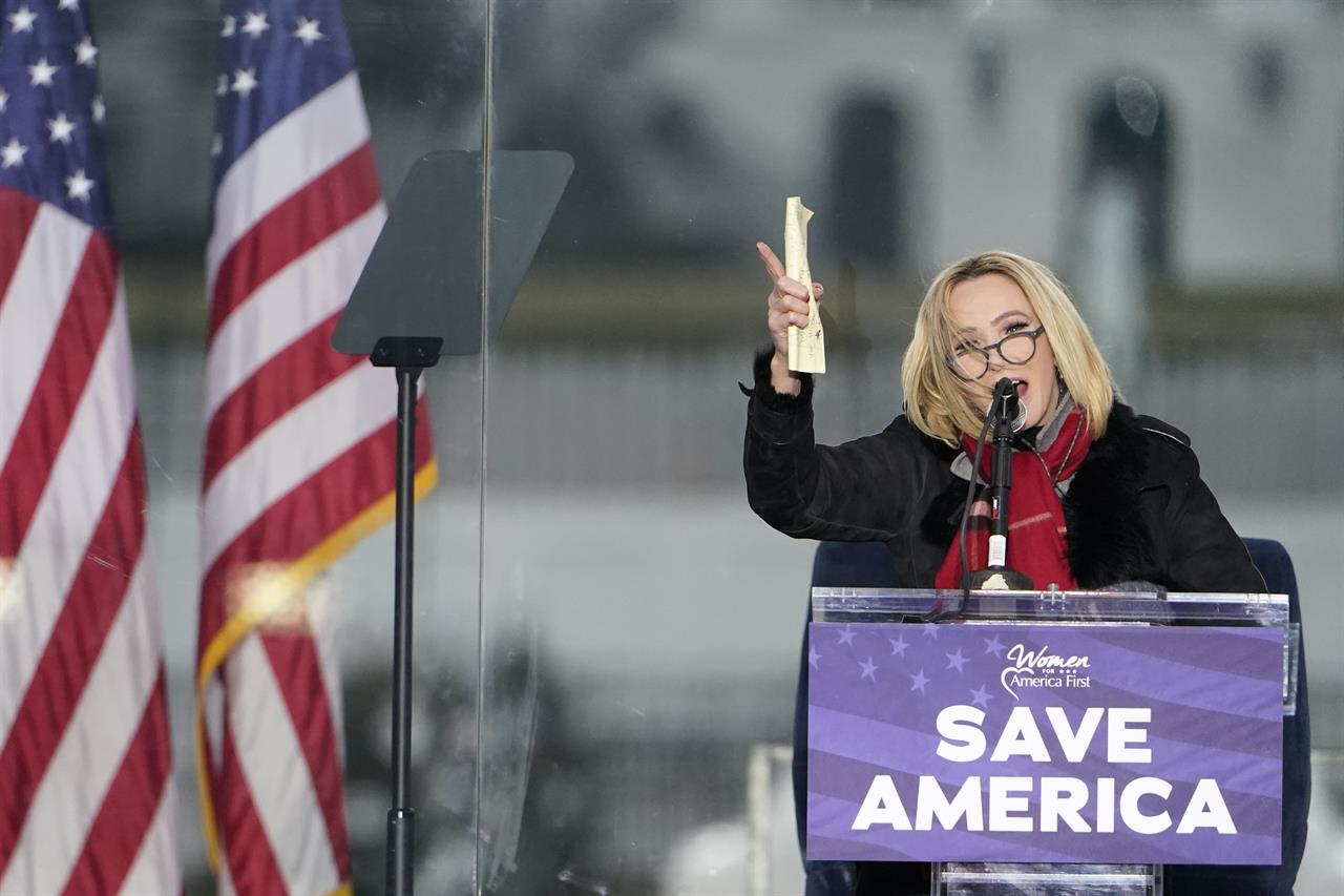 """FILE - In this Wednesday, Jan. 6, 2021 file photo, Pastor Paula White leads a prayer in Washington, at a rally in support of President Donald Trump called the """"Save America Rally.""""  On Sunday, Jan. 10, the first day of Christian worship services since the Capitol riot, religious leaders who have supported the president in the past delivered messages ranging from no mention of the events of that day to incendiary recitations of debunked conspiracy theories. (AP Photo/Jacquelyn Martin, File)"""