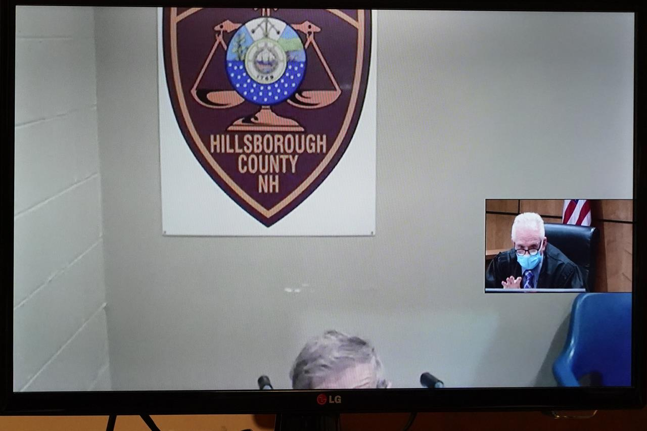 Frank Davis remains mostly hidden as he is arraigned via video while Judge William Lyons presides at right, Thursday, April 8, 2021, at Manchester, N.H. District Court, in connection with sexual abuse allegations at the Sununu Youth Services Center, a state-run youth detention center.  Six former staffers at New Hampshire's state-run youth detention center were arrested Wednesday in connection with the abuse of 11 children over the course of a decade.  (AP Photo/Elise Amendola, Pool)