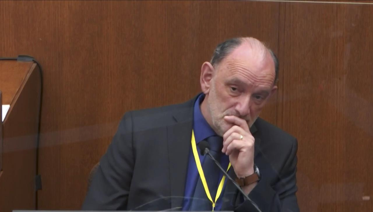 In this image from video, Dr. David Fowler, a retired forensic pathologist and former chief medical examiner for the state of Maryland is questioned by prosecutor Jerry Blackwell, as Hennepin County Judge Peter Cahill presides, Wednesday, April 14, 2021, in the trial of former Minneapolis police Officer Derek Chauvin at the Hennepin County Courthouse in Minneapolis, Minn. Chauvin is charged in the May 25, 2020 death of George Floyd. (Court TV via AP, Pool)