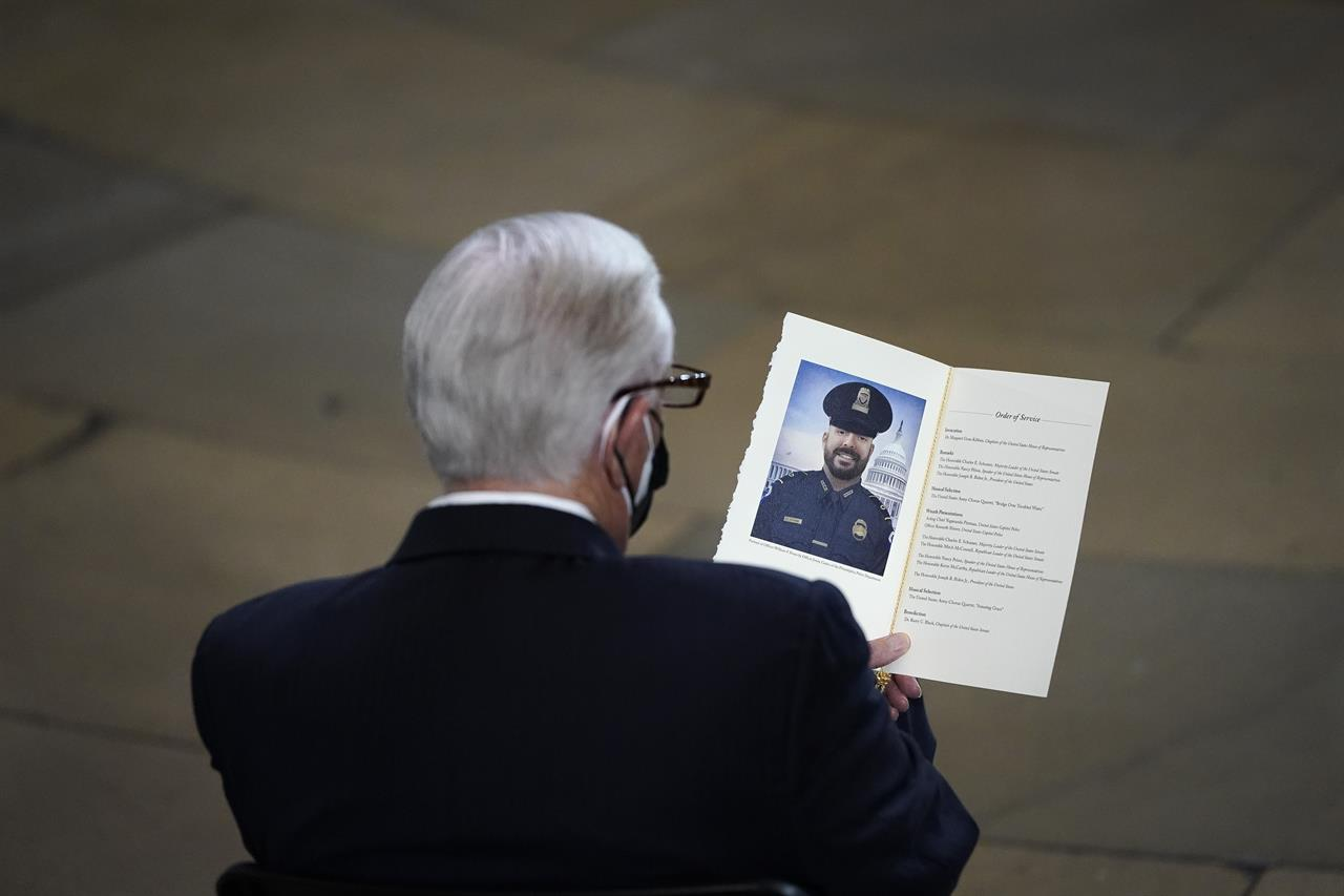 "Rep. Steny Hoyer, D-Md., looks at a program at a memorial service for the late U.S. Capitol Police officer William ""Billy"" Evans in the Rotunda at the U.S. Capitol, Tuesday, April 13, 2021 in Washington. (Drew Angerer/Pool via AP)"