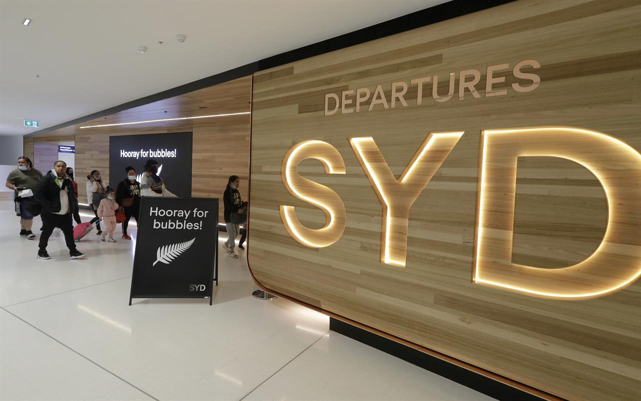 Passengers prepare at Sydney Airport to catch flights in Sydney, Australia, Monday, April 19, 2021, to New Zealand as the much-anticipated travel bubble between Australia and New Zealand opens. (AP Photo/Rick Rycroft)