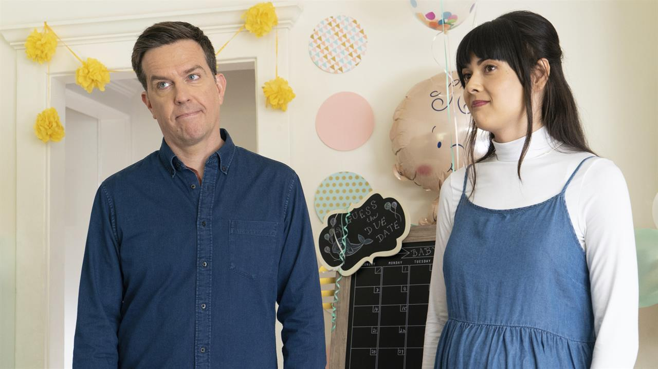 """This image released by Bleecker Street shows Ed Helms, left, and Patti Harrison in a scene from """"Together Together."""" (Tiffany Roohani/Bleecker Street via AP)"""